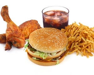 Four Foods to Eat and to Avoid to Fight Acne - Greasy fast food